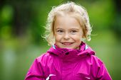 Outdoor portrait of happy little girl
