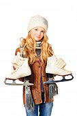 Pretty ten years girl standing with figure skates. Isolated over white.