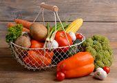 Fresh organic vegetables on wooden background