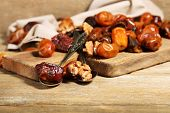 Tasty dates fruits on wooden table