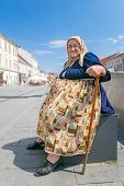 CLUJ NAPOCA, ROMANIA - AUGUST 20: Old women in traditional costume in Cluj Napoca on August 20, 2014.