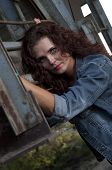 Portrait Of Young Woman Against Grunge Metal Construction