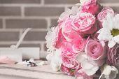Beautiful wedding still life with  bouquet on bricks wall background