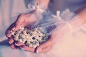 Bride holding pearls in hands
