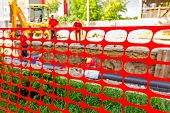image of safety barrier  - Pipeline under construction that is blocked off with a orange fence for safety - JPG
