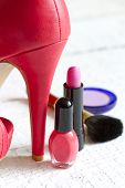 High red heels and set of cosmetics abstract on white