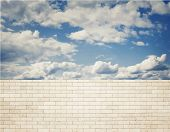Brick wall with clouds and sky