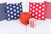 Popcorn and basketball on sofa in room