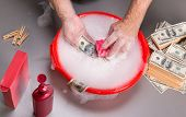 Hands are washing dollars in foam