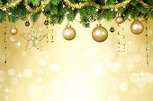 stock photo of christmas greetings  - Christmas balls hanging on fir tree over festive background - JPG