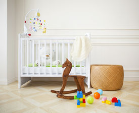 stock photo of flat-bed  - Empty nursery room with basket toys and wooden horse - JPG