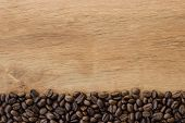 picture of coffee coffee plant  - Coffee beans on a wooden planks background - JPG