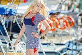 image of flowing hair  - Beautiful blonde with blue eyes and long flowing hair - JPG