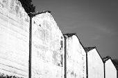 Cemetery wall. Black and white photo
