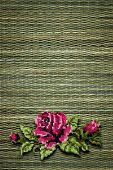 rose on a background of green straw