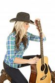 Cowgirl With Guitar In Blue Kneel Look Side