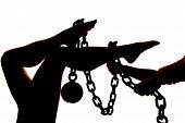 Silhouette Womans Legs Ball And Chain Hands