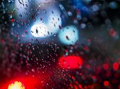 Abstract Images Rain Drops On The Mirror At Night. Take Real Focus Bokeh