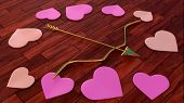arrow and bow with heart shapes on wooden floor