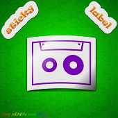 Cassette Icon Sign. Symbol Chic Colored Sticky Label On Green Background. Vector