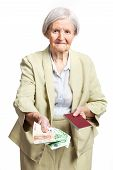 Senior woman giving money and holding passport