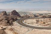 stock photo of jabal  - Jebel Hafeet mountain road in the outskirts of Al Ain Emirate of Abu Dhabi UAE - JPG