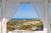 stock photo of beach-house  - Look through beach house window - JPG