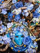Bllue Mask With Floral Decorations Exhibited During The Carnival Of Venice