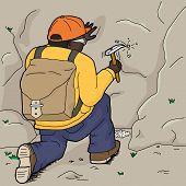 Kneeling Geologist Chipping Rock