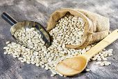 image of phaseolus  - Raw beans in sack and scoop on wood - JPG
