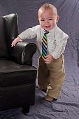 Baby boy with leather chair