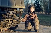 foto of panzer  - Portrait of young boy sitting near by panzer - JPG