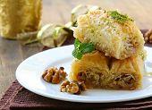 Turkish arabic dessert - baklava with honey and walnut nuts