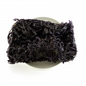 Dried Black Seaweed Close Up Isolated On White Background