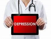 Doctor Showing Tablet With Depression Text.