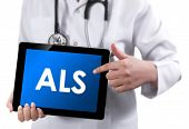Doctor Showing Tablet With Als Text.
