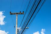 Electric Pole With Blue Sky Background