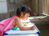 Lovely Kid Practice For Writing On White Broad Before Class Learning In Pre Kindergarten