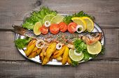 Baked Fish With Fresh Vegetables And Fried Potato