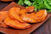 Baked Pumpkin Slices On Plate,