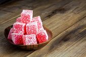 Red Turkish Delight With Coconut In A Wooden Bowl