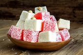 Red And White Turkish Delight With Coconut In A Wooden Bowl