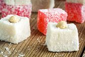 Turkish Delight With Coconut And Nuts In A Wooden Bowl Closeup