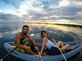 pic of kayak  - Kayaking Selfie Pole young couple doing sports at sunset - JPG