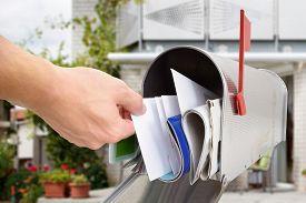 stock photo of mailbox  - Close-up Of Man