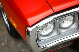 picture of muscle-car  - Color detail on the headlight of a vintage car - JPG