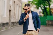 stock photo of e-cigarettes  - stylish handsome bearded man with e - JPG