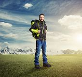 foto of knapsack  - happy tourist with knapsack smiling and looking at camera over beautiful landscape - JPG