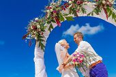 pic of wedding arch  - young loving couple - JPG