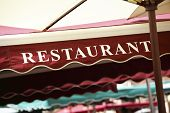 pic of canopy  - Restaurant entrance sign with colorful canopy in Paris - JPG